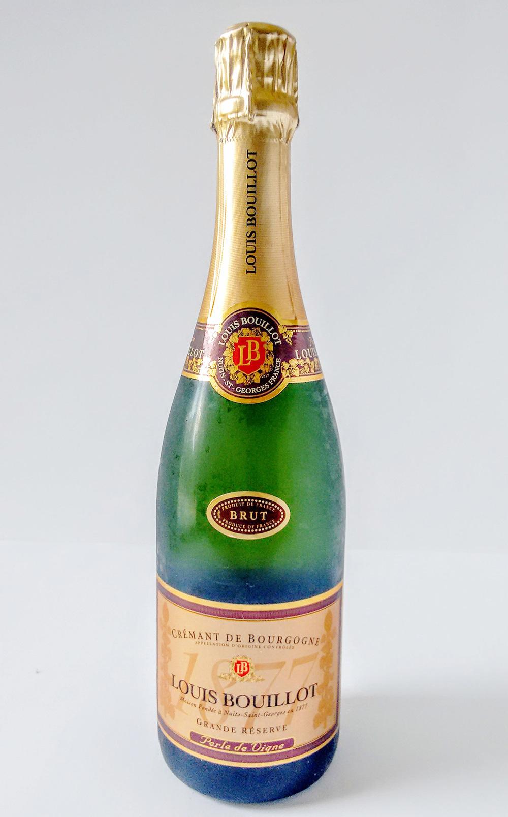 A bottle of louis bouillot cremant de bourgogne