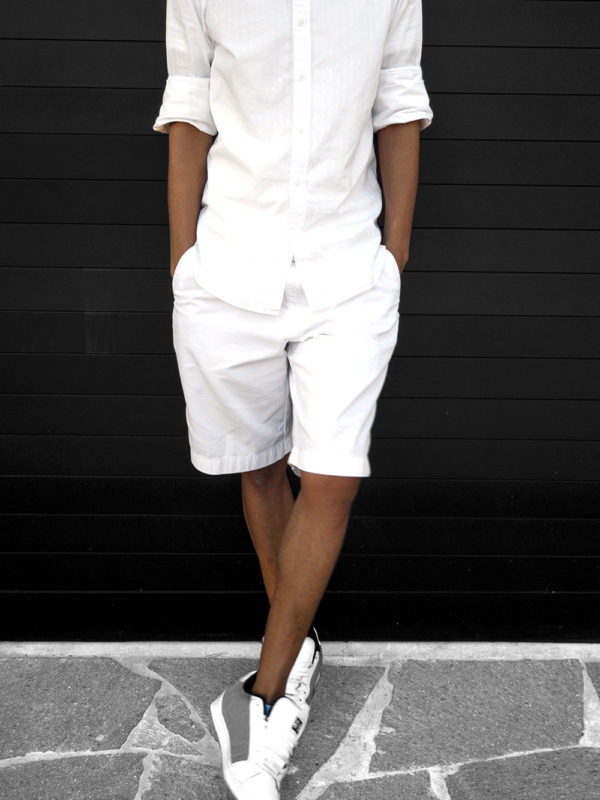 KG wears MJ Bale shirt and Tommy shorts with DC's