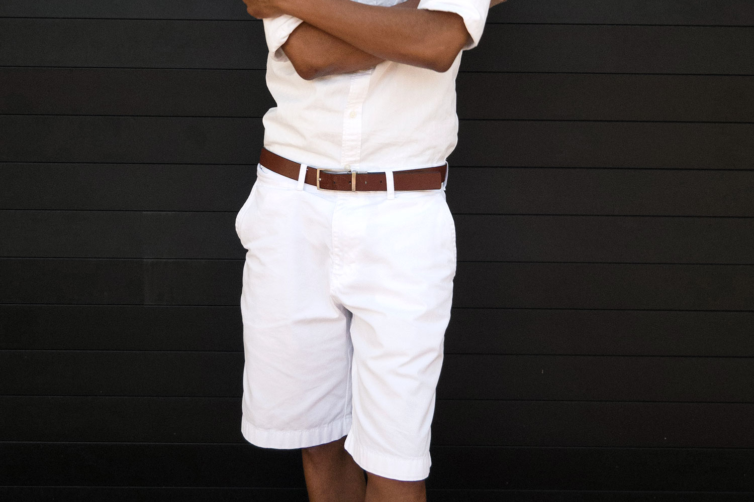 Preppy whites tied together with a tan leather belt