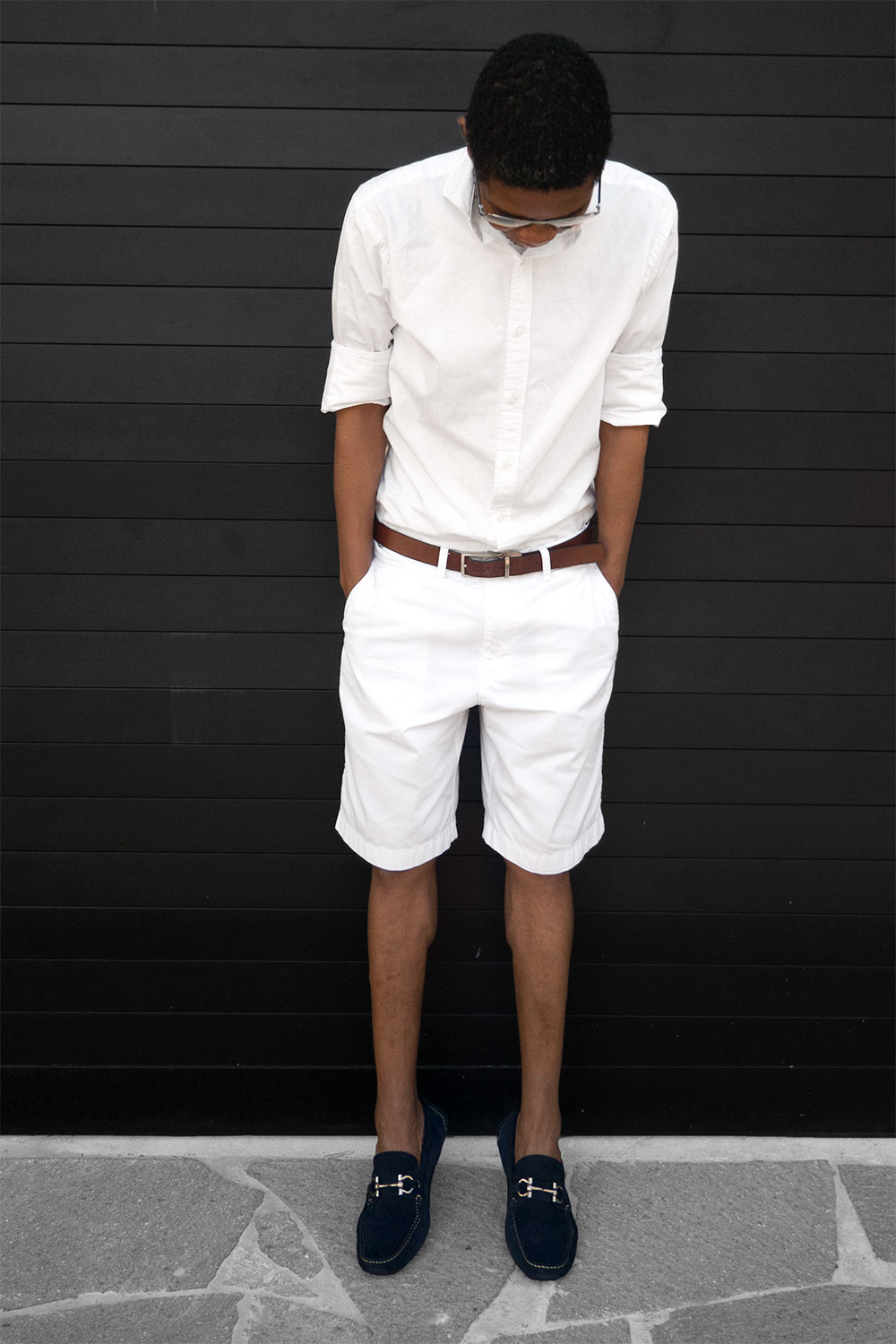 All white style paired with navy blue boat shoes