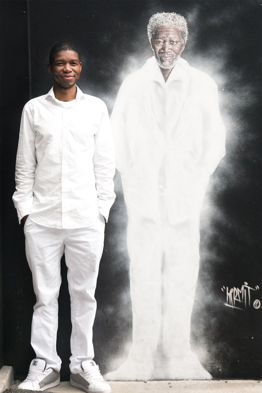 A full length picture of me and Morgan Freeman mural